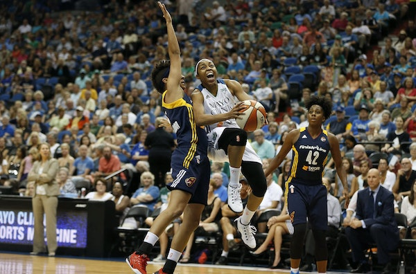 Minnesota Lynx guard Renee Montgomery (21) drives between Indiana Fever guard Layshia Clarendon, left, and guard Shenise Johnson (42) during the first