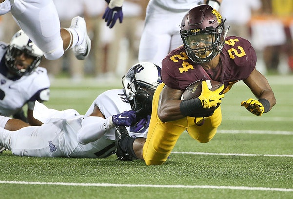 Minnesota's running back Rodney Smith carried the ball to the ten yard line during the third quarter as the Gophers took on TCU at TCF Stadium, Thursd