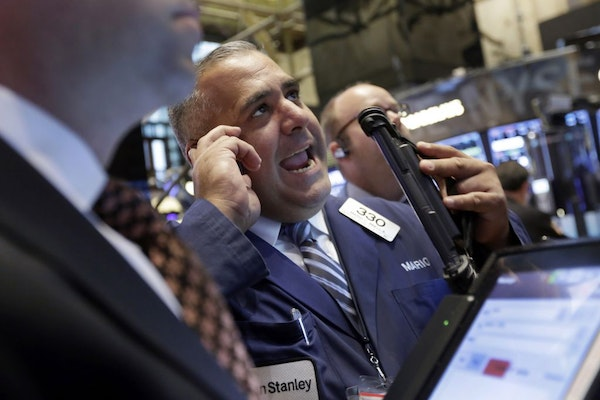 Trader Mario Innella works on the floor of the New York Stock Exchange, Monday, Aug. 24, 2015. U.S. stock markets plunged in early trading Monday foll