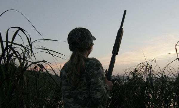 Grace Rodemann, 11, of Carver, scans the sky for ducks during Youth Waterfowl Day in Minnesota.