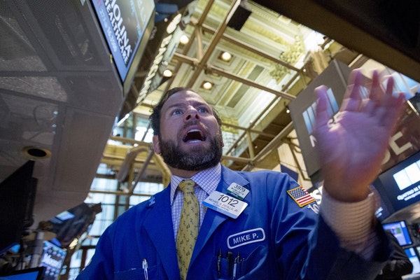 A trader works on the floor of the New York Stock Exchange on Monday morning. Stocks in the U.S. plunged and gyrated as the global selloff appeared to