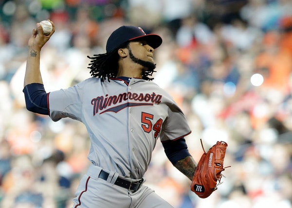 Minnesota Twins' Ervin Santana delivers a pitch against the Houston Astros in the first inning of a baseball game Saturday, Sept. 5, 2015, in Houston.