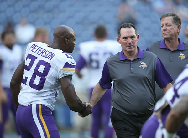 Vikings head coach Mike Zimmer shook hands with all the players, including Adrian Peterson, as they stretched before a preseason game this summer. Zim