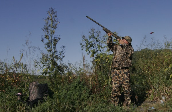 Sam Olson, 14, of Minnetonka, fired at a duck Saturday on Youth Waterfowl Day while hunting in the Minnesota Valley National Wildlife Refuge near Shak