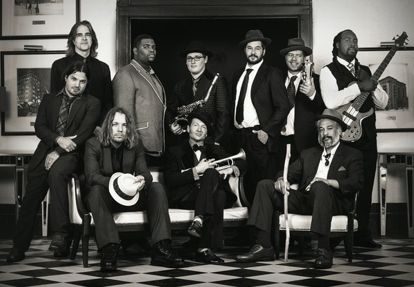 Funk/reggae/rap ensemble Irie Sol is releasing a concept album centered around author F. Scott Fitzgerald. Band leaders are Joel Pace, seated center,