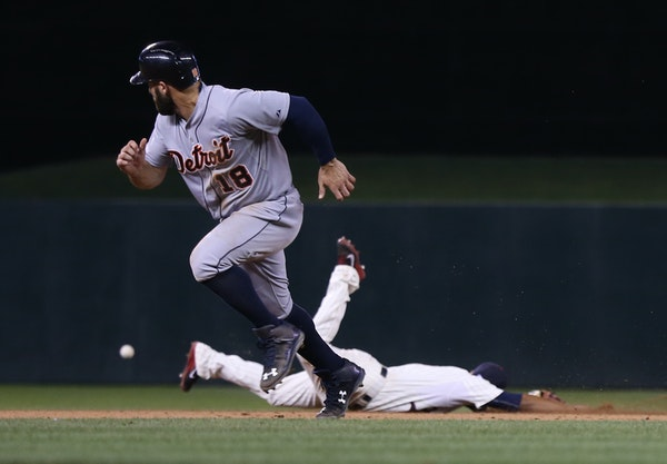 Tyler Collins watched the ball go passed the Twins' Eduardo Escobar. Detroit went ahead in the ninth inning on the play.