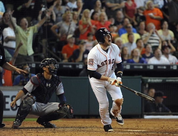The Astros' Jed Lowrie watched his grand slam in the seventh inning against the Twins on Sunday.