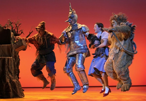 From left: Dean Holt as the Scarecrow, Max Wojtanowicz as the Tin Man, Maeve Coleen Moynihan as Dorothy Gale, Loki the dog as Toto and Reed Sigmund as