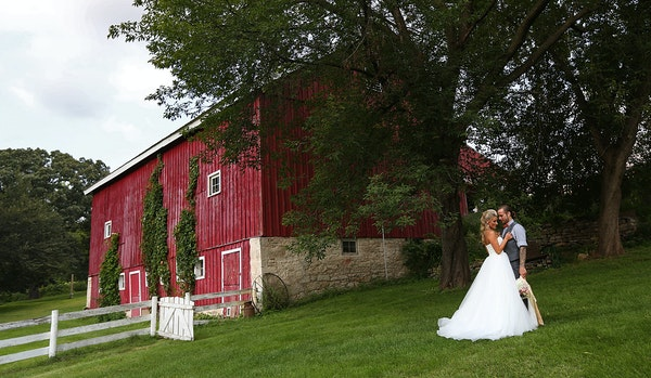Newlyweds Savannah and Jeremy Eckert posed for photographs at Hope Glen Farm, which has hosted 98 weddings so far this year.