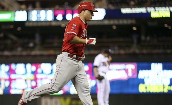 Los Angeles Angels center fielder Mike Trout trotted home after his second homer of the game, a solo shot in the fourth inning off Twins relief pitche