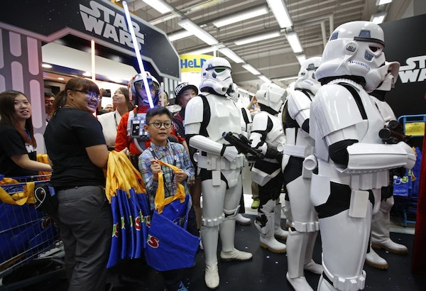 """Star Wars fans shop at a toy store at midnight in Hong Kong, Friday, Sept. 4, 2015 as part of the global event called """"Force Friday"""" to release new St"""