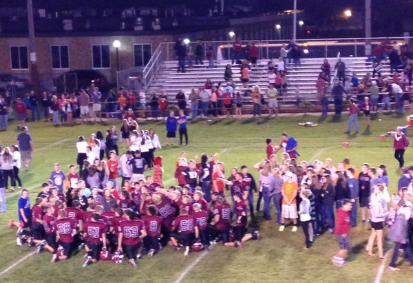 Moments after the Staples-Motley Cardinals broke a 39-game losing streak on Friday, fans stormed the football field to celebrate a 24-14 victory, last