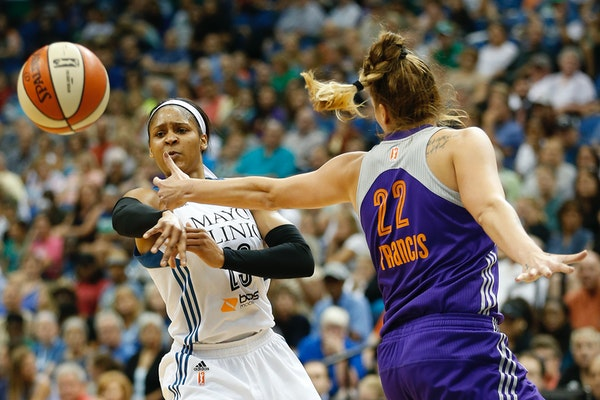 Minnesota Lynx forward Maya Moore (23) makes a pass against Phoenix Mercury center Cayla Francis (22) during the first half of a WNBA basketball game,