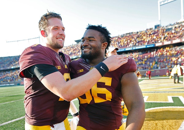 Minnesota's quarterback Mitch Leidner, left, and defensive tackle Steven Richardson celebrated their 27-24 victory over Ohio at TCF Bank Stadium, Satu