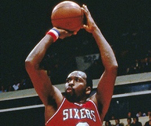 Moses Malone ranks among the leaders in points and rebounds in the NBA.