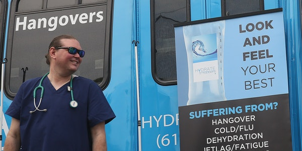 Paramedic Brett Willis waited for clients outside the Hydrate IV Therapy bus by Lord Fletcher's in Spring Park.