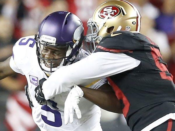 Minnesota Vikings quarterback Teddy Bridgewater (5) was sacked by Aaron Lynch (59) in the fourth quarter.