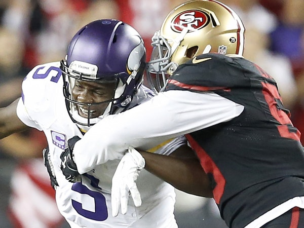Minnesota Vikings quarterback Teddy Bridgewater (5) was sacked by Aaron Lynch (59) in the fourth quarter of Monday's season-opener in San Francisco.