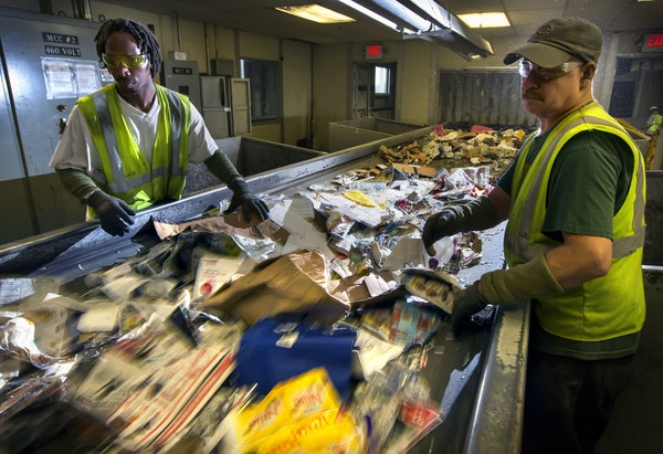 single sort: Jerrell Stewart, left, and Martin Kellers worked the sort line at Dem-Con recycling facility in Shakopee.