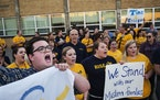 9/22/15 in Columbia Heights: Choir teacher Alex Jacques, far left, led teachers who called for