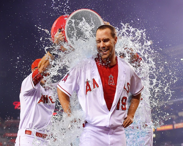 Angels outfielder David Murphy was doused by teammates Taylor Featherston, left, and Matt Joyce after Murphy hit a walk-off single to send Los Angeles
