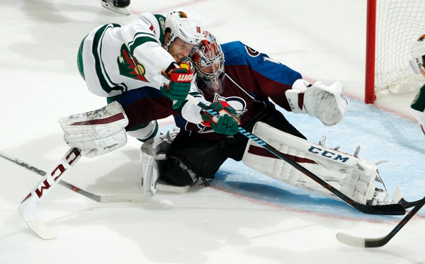 Wild left winger Jason Zucker had this shot blocked by Avalanche goalie Semyon Varlamov, but the Wild beat him four times in the third period to beat