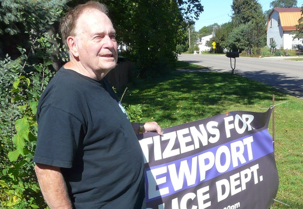 Fred Leimbek, a retired Newport police officer, has a sign in his yard facing City Hall, calling on residents to turn out for a council meeting in Oct