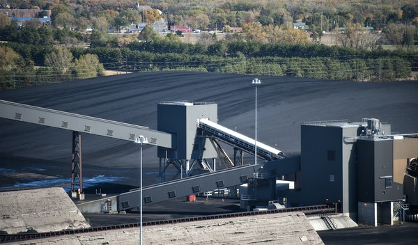 Stockpiled coal at Xcel Energy's Sherco plant in Becker, Minn. The utility is planning to retire two of three coal burners, replacing them with a gas-