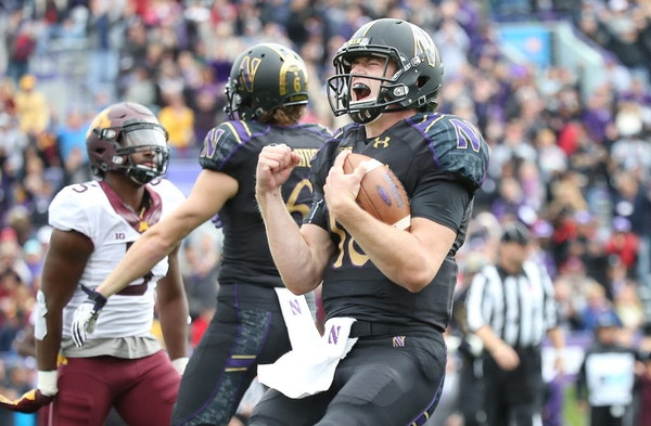 Northwestern quarterback Clayton Thorson celebrated after running the ball for a touchdown against Minnesota in Evanston, Ill.