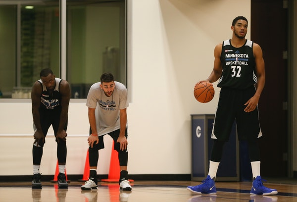 Wolves center Karl-Anthony Towns, right, with guard Ricky Rubio and forward Shabazz Muhammad, left, during the team's first practice Tuesday evening.