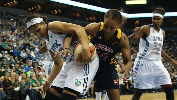 Tamika Catchings and Maya Moore fought for possession during the 2012 WNBA Finals.