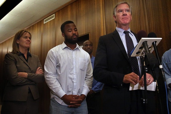 Rashad Turner, second from left, the leader of the St. Paul chapter of Black Lives Matter, joins St. Paul Mayor Chris Coleman, right, and Deputy Mayor