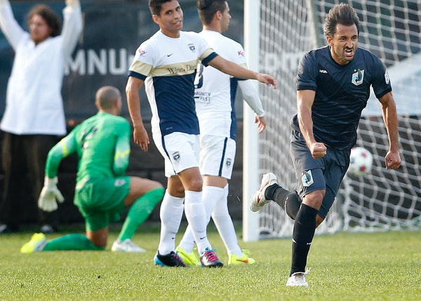 Juliano Vicentini (77) of Minnesota United FC celebrated after scoring a goal in July. The Loons play on the road in Atlanta on Tuesday.