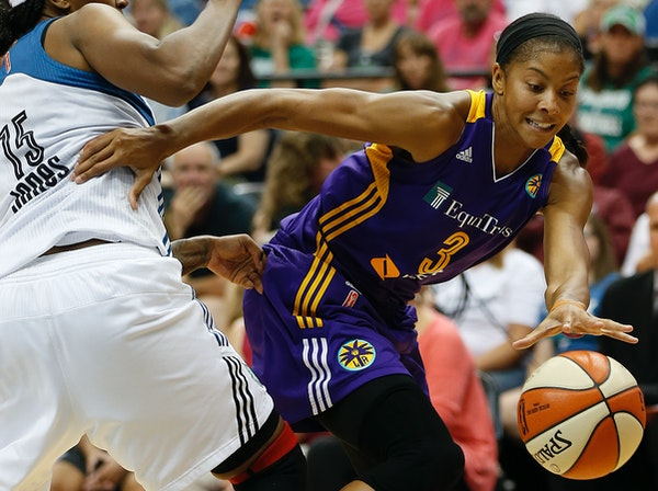Los Angeles Sparks star Candace Parker dribbled around Lynx forward Asjha Jones when the Lynx and Sparks played on July 29.