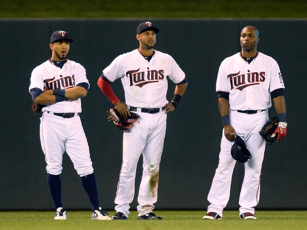 From left, Minnesota Twins left fielder Eddie Rosario (20), center fielder Aaron Hicks (32) and right fielder Torii Hunter (48) all looked on as relie
