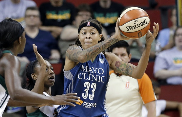 Minnesota Lynx's Seimone Augustus (33) looks for room to pass against the Seattle Storm during the second half of a WNBA basketball game Thursday, Jun