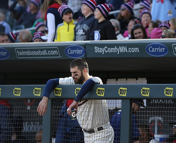 Twins Joe Mauer stood in the dugout during the ninth inning.