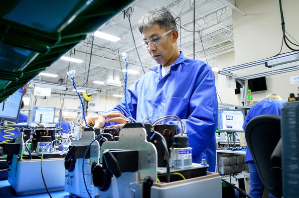 Smiths Medical's Ko Saysong Khan assembled devices at the firm's Oakdale facility. Organic revenue growth of 4 percent is the company's best in