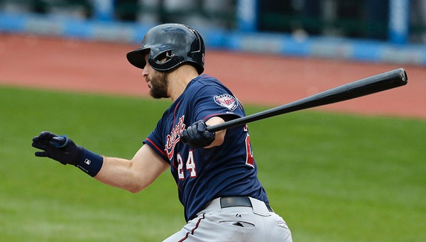 Minnesota Twins' Trevor Plouffe hits an RBI-single off Cleveland Indians starting pitcher Carlos Carrasco in the fourth inning of the first baseball g