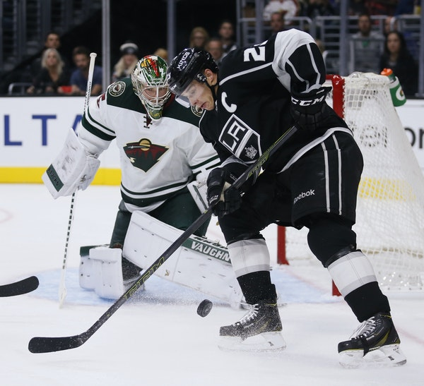 Wild goalie Darcy Kuemper got in position as Los Angeles right winger Dustin Brown tried to corral the puck.