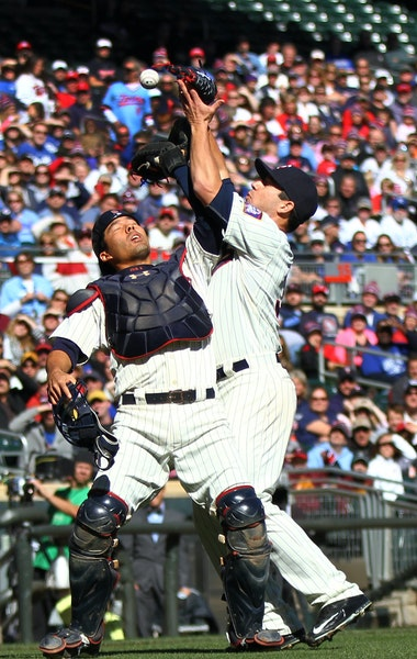 Twins catcher Kurt Suzuki and pitcher Tommy Milone collided while trying to catch a popup off the bat of Salvador Perez in the second inning. Suzuki w