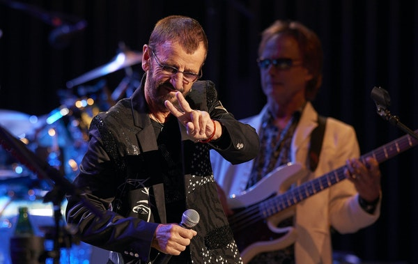 Ringo Starr didn't skimp on the peace signs Friday night at the State Theatre in Minneapolis.
