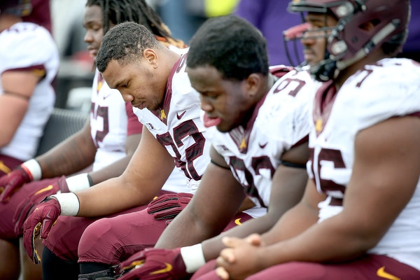 Minnesota's defensive lineman Robert Ndondo-Lay sat on the sideline during the last few minutes of the game as the Northwestern Wildcats defeated Minn