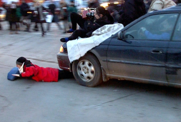 A car plowed through a Ferguson rally in south Minneapolis after protesters blocked the intersection of Lake Street and Minnehaha Avenue on Tuesday, N