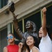 From left, Shanell Carter, Alana Ingram-Diego and Alayna Ap, all of St. Paul, posed for their friend's camera phone on the Mary Tyler Moore statue o