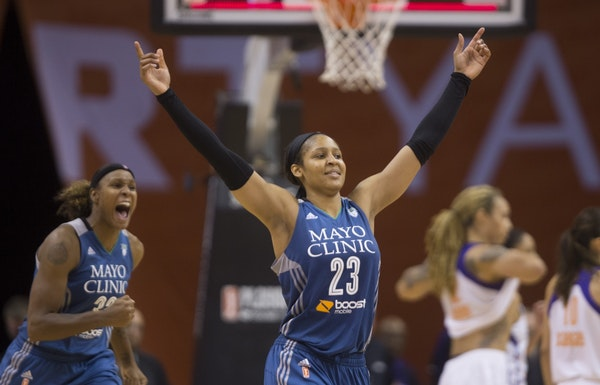 Lynx' Maya Moore (23) celebrates making a steal and game winning free throw against the Mercury during game 2 of the Western Conference Finals at Talk