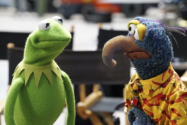 """Kermit the Frog, left, and Gonzo the Great appear in a scene from """"The Muppets."""""""