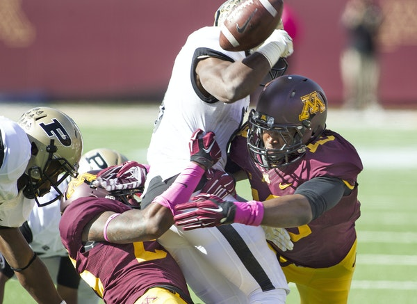 Linebacker Jonathan Celestin, right, caused Boilermakers running back Raheem Mostert to fumble in a game last year.