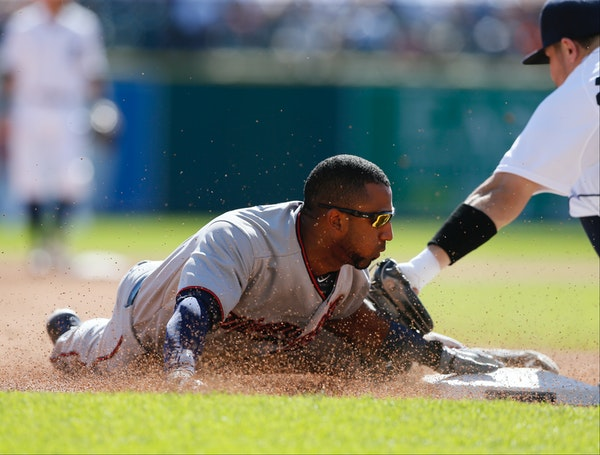 Minnesota Twins' Eduardo Nunez beats the tag of Detroit Tigers' 'Nick Castellanos as he steals third base during the fifth inning on Sunday, Sept. 27,