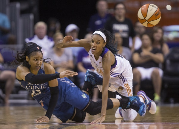 Lynx forward Maya Moore made a pass while falling down in front of the Mercury's DeWanna Bonner. Moore scored 40 points, a playoffs high for her.